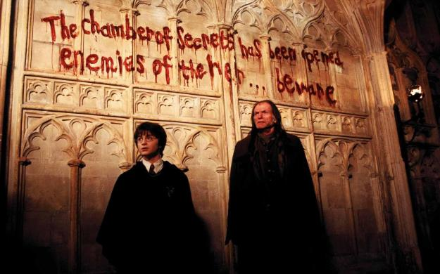still-of-david-bradley-and-daniel-radcliffe-in-harry-potter-and-the-chamber-of-secrets-(2002)-large-picture